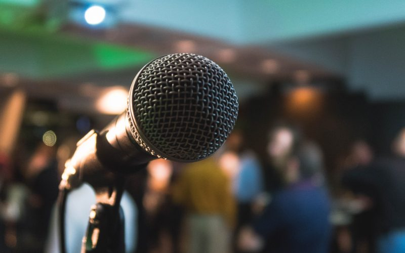 A photo of a microphone on a stage